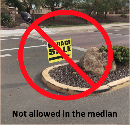 Not allowed yard sale sign median