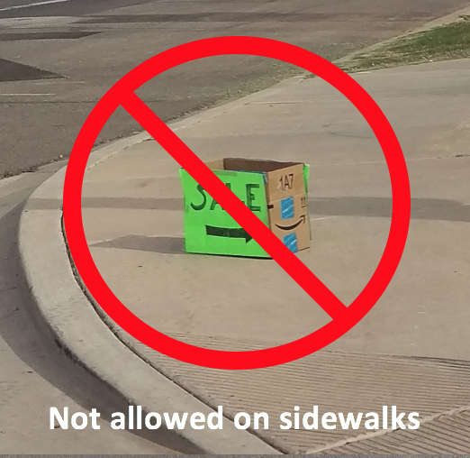 Not allowed yard sale sign sidewalk