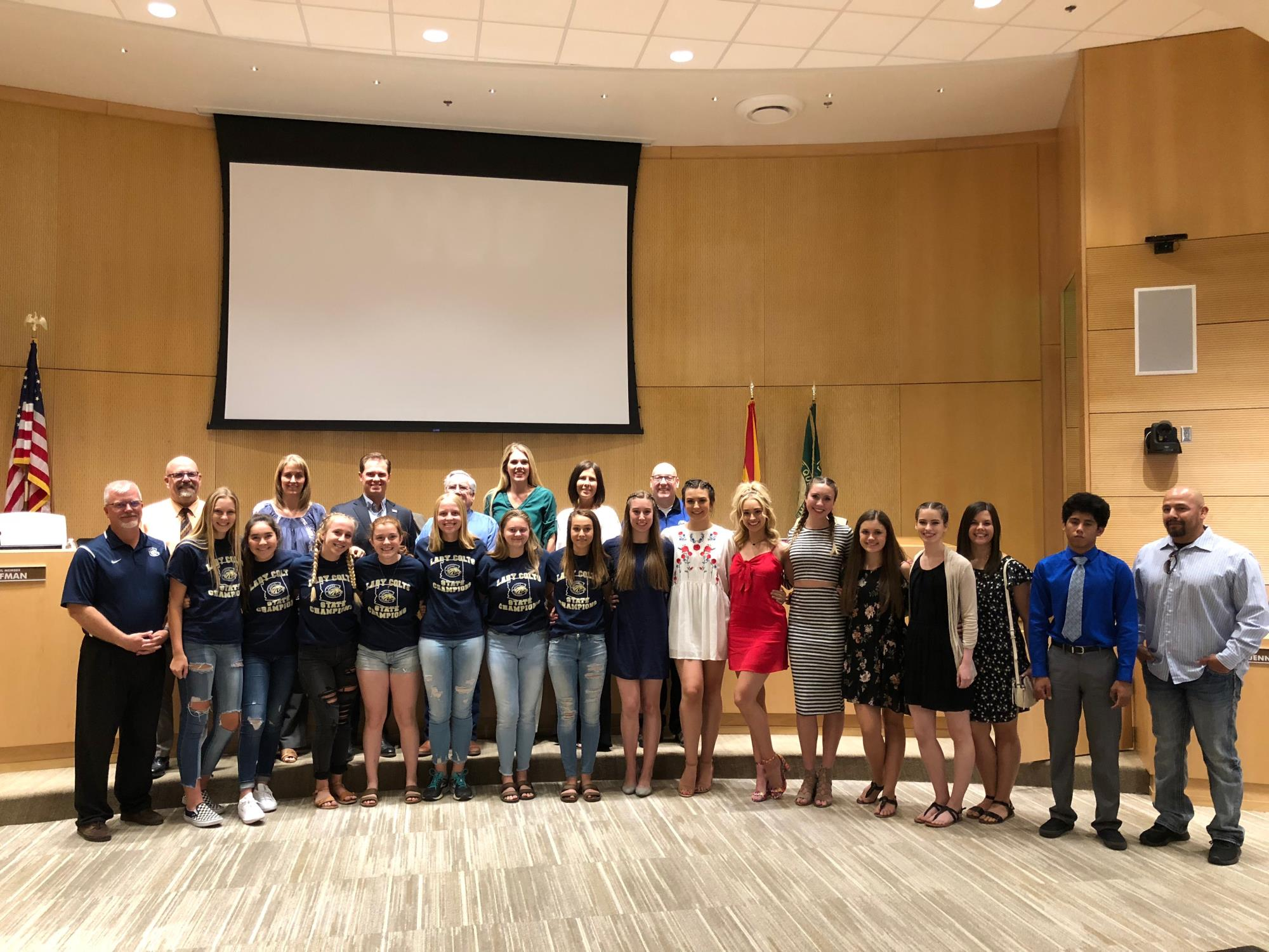Mayor Barney and the Town Council with the Casteel High School State Champion Women's Soccer Team, Women's Spirit-line / POM Team, and Men's Wrestler during the May 2 Town Council Meeting