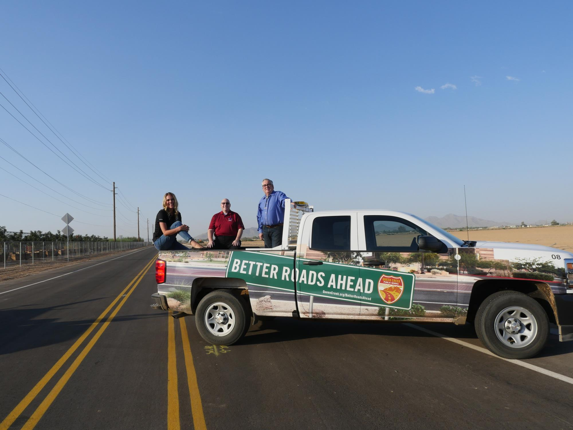 Mayor Barney and Council Members Brown and Wheatley in the Better Roads Ahead Truck at the Crismon Road Ribbon Cutting on August 7