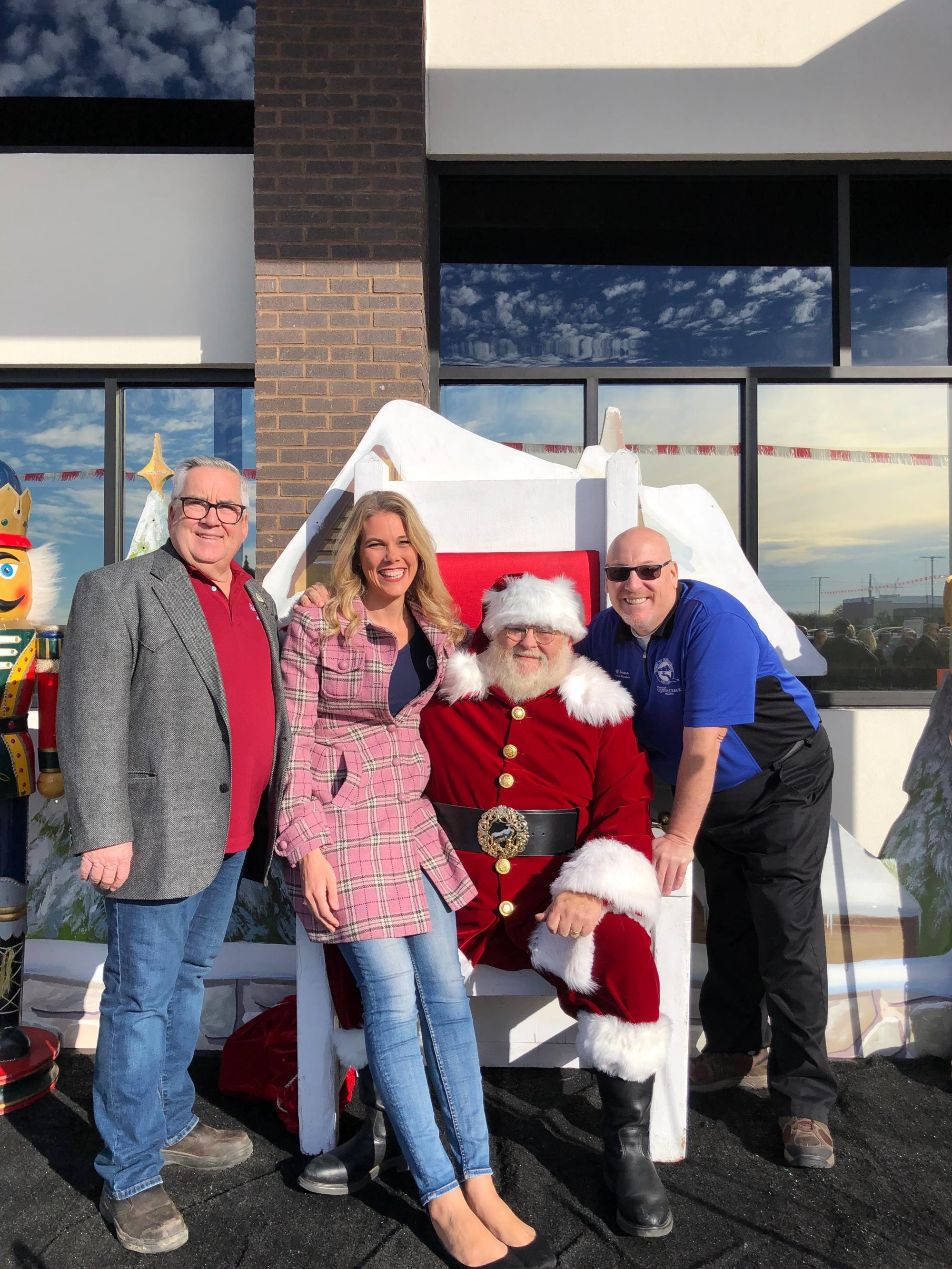 Mayor Barney and Council Members Brown and Wheatley with Santa on December 5