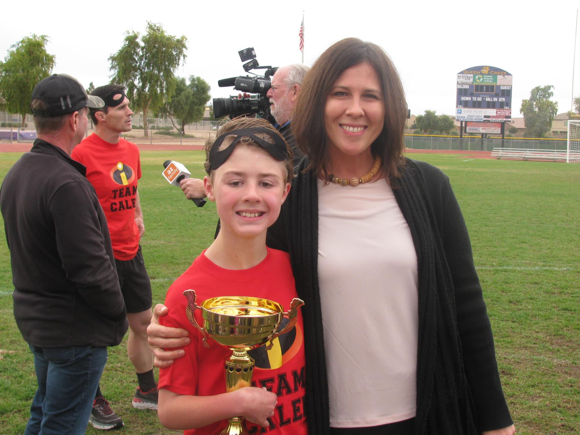 Vice Mayor Turley with Caleb Schroeder after Caleb completed his Super Hero Dash on December 15